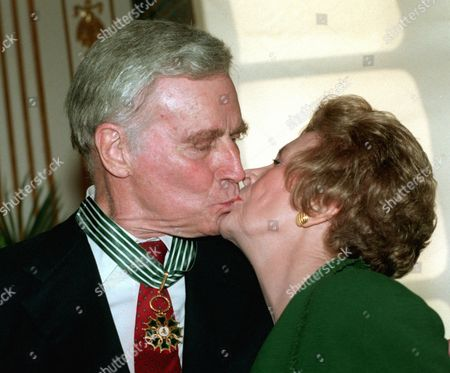 HESTON CLARKE US movie star Charlton Heston kisses his wife Lydia Clarke after he was named Commander in the Arts and Letters Order at the French culture ministry in Paris . Charlton Heston celebrated today their 53rd anniversary of marriage