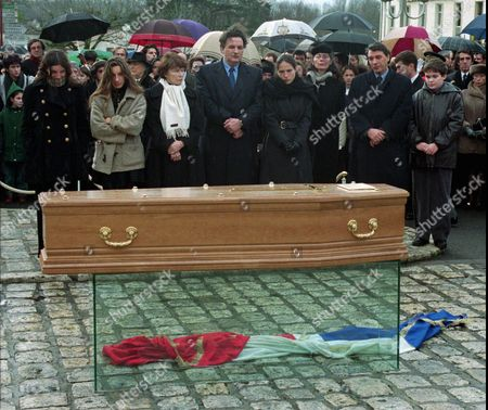 MITTERRAND The family of former French President Francois Mitterrand, stand behind his coffin after the wind blew the national flag on the ground, during the funeral ceremony in Jarnac,southern France, . From left are: Mitterrand's grandaughters Justine,Pascale, widow Danielle Mitterrand,son Jean-Christophe Mitterrand,Mazarine, the daughter out-of-marriage of the former French President, her mother Anne Pingeot, son Gilbert Mitterrand, and grandson Adrien Mitterrand