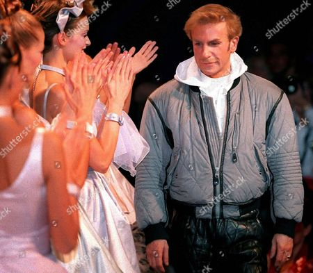 MONTANA French fashion designer Claude Montana is applauded by models in this photo. Montana, who first made a name for himself 20 years ago with leather and lots of shoulder pads, filed for bankruptcy in a French court last month, court documents consulted Tuesday Nov.18,1997, show The filing came just a few days after the Paris show for his new spring-summer collection. His company is now in a six-month observation period