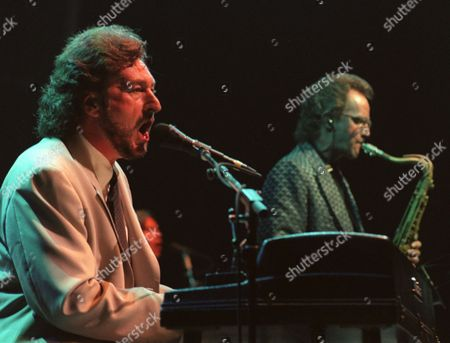 """Supertramp singer and keyboards player Rick Davies, left, sings while John Helliwell plays the saxophone during the band's concert in Paris to start their """"Some Things Never Change"""" tour. Supertramp had not performed live for 10 years"""