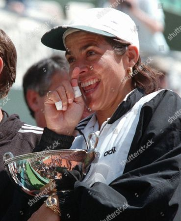 FERNANDEZ Gigi Fernandez of the USA holds the winner cup after defeating, with Bulgarian teammate Natasha Zvereva the American pair Mary-Joe Fernandez and Lisa Raymond in the final of the women's double of the French Open tennis tournament in Paris . Zvereva-Fernandez won 6-2, 6-3