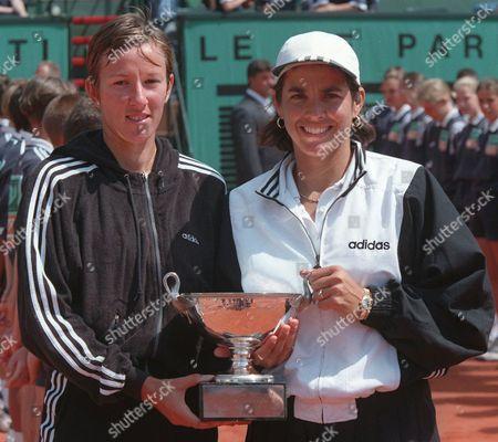 FERNANDEZ ZVEREVA Natasha Zvereva of Bulgaria, left, and Gigi Fernandez of the USA holds the winner cup after defeating the American pair Mary-Joe Fernandez and Lisa Raymond in the final of the women's double of the French Open tennis tournament in Paris . Zvereva-Fernandez won 6-2, 6-3