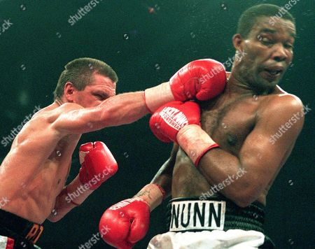 ROCCHIGIANI NUNN ACTION German boxer Graciano Rocchigiani, left, punches to the head of U.S. Amercan boxer Michael Nunn fom Los Angeles, California, right, during their vacant light heavyweight WBC championship title fight in Berlin, Germany, Saturday night, . Rocchiginai won by points after twelve rounds