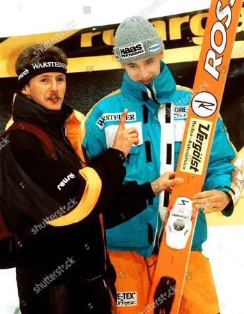 SCHMITT WEISSFLOG Former German Olympic champion Jens Weissflog, left, points at German Martin Schmitt, right, before the beginning of the K120 World Cup Ski jumping competition in Oberhof, eastern Germany
