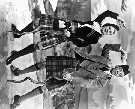 """ROGERS ASTAIRE Ginger Rogers poses with Fred Astaire in this undated publicity photo for the movie musical, """"The Barkleys of Broadway"""