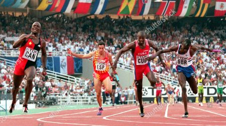 Donovan Bailey, left, anchors the Canadian team to the gold medal in the final of the Men's 4x100 meters relay at the World Track and Field Championships in Athens . Others in photo are from left: Carlos Berlanga of Spain, 7th, Luis Perez-Rionda Alberto of Cuba, 4th and Julian Golding of Britain who took the bronze