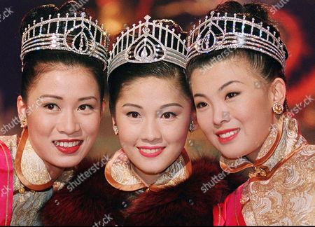 Stock Image of YUNG, LEE, SHEH Virginia Yung Ka Shui, center, a 23-year-old student, is crowned Miss Hong Kong, at the annual beauty pageant organized by a Hong Kong television network. Yung is flanked by first runner-up Vivian Lee Ming Wai, right, a 21-year-old accountant, and second runner-up Charmaine Sheh, 22, a student