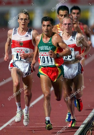 Gold medal winner Antonio Pinto of Portugal, center, is followed by Germany's silver medalist Dieter Baumann, left, and bronze medalist Stephane Franke also of Germany, right, in the Men's 10,000 meters final at the European Track and Field Championships at the Nep Stadium in Budapest on