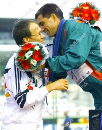 Gold medallist Antonio Pinto of Portugal, and German silver medallist Dieter Baumann embrace, after the presentation ceremony for the Men's 10,000-meters at the European Track and Field Championships in Budapest, Wednesday Aug.19, 1998
