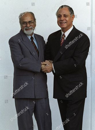 GUJRAL KHAN United Front prime ministerial candidate Inder Kumar Gujral, left, hugs Pakistani Foreign Secretary Gauhar Ayub Khan at a meeting in New Delhi in this f picture. Gujral is widely credited for improving relations with India's historical enemy Pakistan. The choice to make Gujral prime minister was announced by the United Front, Saturday