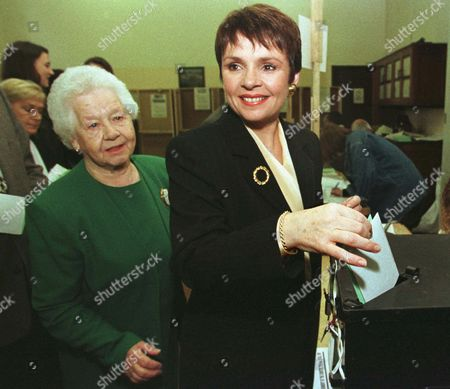 DANA BROWN Dana Rosemary Scallon, right, casts her ballot in Dublin Ireland for the Irish presidential election as her mother Sheila Brown looks, . Dana, who lives with her family in Birmingham, Alabama, is one of five candidates running for president. There are four women candidates taking part in the election, with the results to be counted on Friday