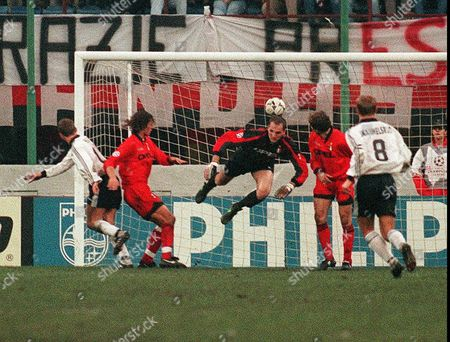 Stock Photo of HEGGEM MALDINI ROSSI Rosenborg midfielder Vegard Heggem, left, and Milan's defender Paolo Maldini, next to him, look the ball entering Milan's net after Heggem's header, as Milan's goalkeeper Sebastiano Rossi, center, failed to stop the ball during their Champions League match in Milan . Sebastiano Rossi was especially targeted by angry Milan's fans shouting insults at players and hurling stones after the team's elimination from the competition