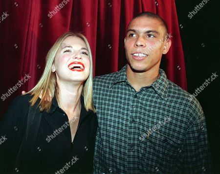 RONALDO Brazilian striker of Inter Milan Ronaldo poses with his girlfriend Susana Werner at the end of the Swish jeans Spring/Summer 1998 fashion collection, presented in Milan