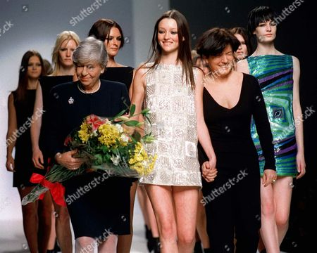 SCHOEN DOMENICI German fashion designer Mila Schoen, left, parades on the catwalk with her models and designer Anna Domenici, right front, at the end of her fall-winter 1998-99 fashion collection, presented in Milan