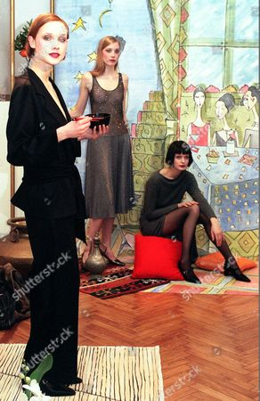 A model, at left, wears a black kimono inspired outfit part of Rebecca Moses' Fall/Winter 1998/1999 ready-to-wear collection unveiled in Milan, Saturday, March7, 1998. In background other two model part of the same collection