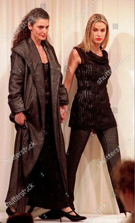 BARZINI MINETTI Italian former model Benedetta Barzini, at left, is shown hand in hand with Annalisa Minetti, the blind winner of the Sanremo song festival, as both appear on the catwalk for Marina Spadafora, at her Fall-Winter fashion collection unveiled in Milan