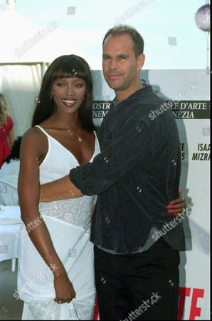 Stock Photo of CAMPBELL KEEVE Top model Naomi Campbell and American movie director Douglas Keeve embrace each other at the Venice Lido, . Naomi Campbell stars in Keeve's movie ''Unzipped'' that will show out of competition at the Venice Film Festival on Sept. 1st