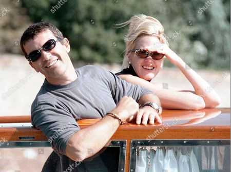 """Stock Image of GRIFFITH BANDERAS American actress Melanie Griffith and her husband, actor Antonio Banderas, smile as they arrive on a taxi speedboat at the Lido for the Venice Film Festival . Griffith stars in the Larry Clarke film """"Another Day in Paradise"""" which will be presented out of competition Friday, Sept. 11"""