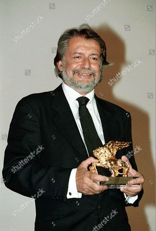 LAUDADIO Felice Laudadio, director of the Venice film festival, holds a Golden Lion award trophy . The festival was in a frenzy even before the prizes were handed out because of the surprise resignation of Laudadio, who called the competition stupid and arrogant. Laudadio, in his second year as the head of the prestigious festival, said he thought there were too many movies - and too many prizes
