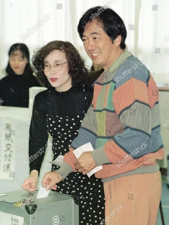 NAOTO NOBUKO KAN Naoto Kan, co-leader of Democratic Party, and his wife Nobuko drop their ballots at a polling station in Tokyo . Japanese voters choose members of the 500-seat House of Representatives