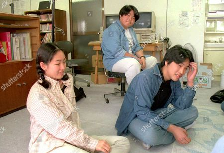 """AKIYAMA NAKAMURA KOBIYAMA 18--Shiori Akimoto, 14, left, Jun Kobiyama, 14, center, and Makoto Nakamura, 14, are shown during an interview, at the privately-run Nayuta club in Tokyo. The club is for """"school refusers,"""" as they are known, and their parents. The three are among the swelling ranks of students who are so frustrated, bullied or troubled in Japan's strict and fiercely competitive school system that they either miss dozens of days a year or refuse to attend at all"""