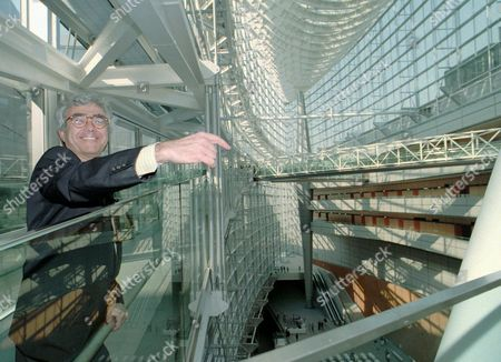 VINOLY American designer Rafael Vinoly smiles in his competition winning work, Tokyo International Forum, a new multi-purpose convention complex being built at center of Tokyo, during a press tour . The glass-covered building uses American glasses made by Guardian Corp. stationed in Urban Hill, Mich., for one third of the entire glasses covering this structure