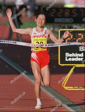 NOBUKO FUJIMURA Japan's Nobuko Fujimura grimaces as she crosses the finish line to win the Tokyo International Women's Marathon . Fujimura finished in 2 hours, 28 minutes, 57 seconds, followed by Manuela Machado of Portugal and Britain's Liz McColgan