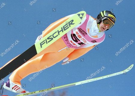 JENS WEISSFLOG German jumper Jens Weissflog soars in the air during the largehill competition of the World Cup Ski Jumping in Sapor, northern Japan, . Weissflog, who won yesterday's normal hill competition, scored 205.5 points and placed fourth