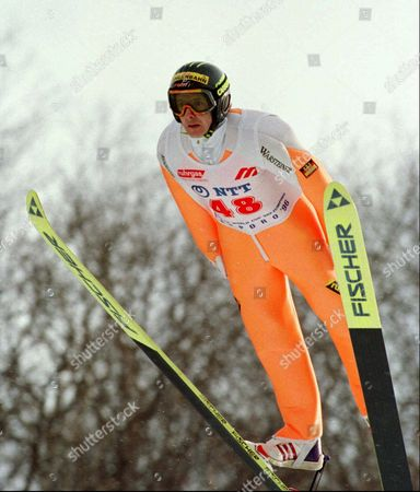 JENS WEISSFLOG Jens Weissflog of Germany soars through the sky during the normal hill competition of the World Cup Ski Jumping in Sapporo, northern Japan, . Weissflog scored total 218.0 points and won the competition