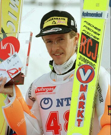 "JENS WEISSFLOG EJens Weissflog of Germany shows off a plaque and special prize he won in the normal hill competition of the World Cup Ski Jumping in Sapporo, northern Japan, . Weissflog, who had announced his decision to retire after this season, scored total 218.0 points to capture the victory. Chinese characters written on the prize envelope read ""No. One"