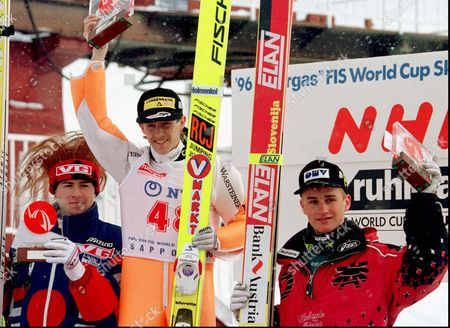 SCHWARZENBERGER Winners of the normal hill competition of the World Cup Ski Jumping celebrate their victory on the podium during an awarding ceremony in Sapporo, northern Japan, . From left: Second place winner Eirik Halvorsen of Norway, Competition winner Jens Weissflog of Germany, and third place winner Reinhard Schwarzenberger of Austria