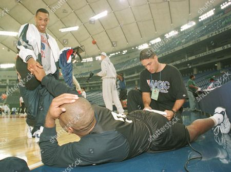 KITTLES SCOTT New Jersey Nets guard Kerry Kittles, left, pulls a hand of Dennis Scott, lying, of Orland Magic as Scott gets some massage after a practice session at the Tokyo Dome in Tokyo . Nets and Magic will play in two games on Thursday and Saturday
