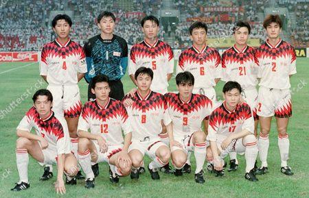 CHINA TEAM PHOTO The Chinese soccer team pose prior to their Asian-final round Olympic qualifying soccer match against Kazakhstan in Shah Alam . From left, behind: Enhua Zhang, Gang Sun, Ming Li, Yue Liu, Ende Tan, Qi Zhu. From left, front: Hui Xie, Chen Yang, Jianjun Sun, Si Shen, Xia Yao. China won 4-2