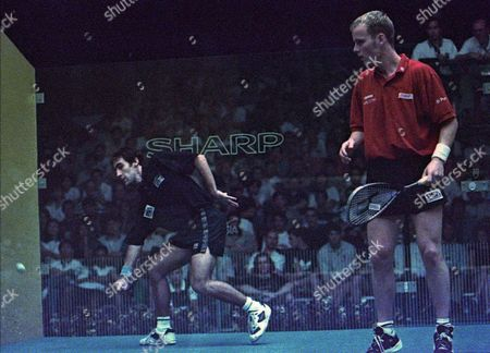GOUGH Scotland's Peter Nicol, right, watches as Wales'Alex Gough, left, goes low to return Nicol's shot during the semi-final of the 1997 Men's World Open Squash Championship in Kuala Lumpur Saturday November 8,1997. Peter defeated Alex 15/13, 15/8,15/5