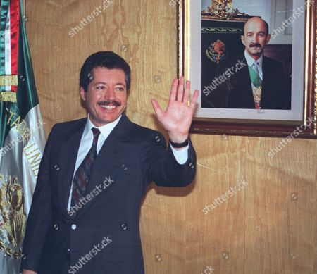 "Luis Donaldo Colosio, then secretary of social development, greets reporters in his Mexico City office, after he was named the ruling Institutional Revolutionary Party's presidential candidate. The film ""Colosio,"" directed by Mexican Carlos Bolado, portrays the 1994 killing of a candidate who was almost certain to be the next president, casts doubts on the official conclusion that a lone gunman planned and carried out the killing of Colosio, which is often compared to John F. Kennedy's assassination. It is one of several new politically minded films being released just ahead of Mexico's July 1 election that are aimed at reminding Mexicans of the dark side of the Institutional Revolutionary Party, which governed Mexico for 71 years, and which seems set to return to power"
