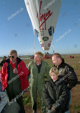 From the left, Per Lindstrand, British Virgin Tycoon Richard Branson, Rory McCarthy and Sam Branson, son of Richard Branson, wait for the start of Branson's attempt to fly non-stop around the world in a hot air balloon, in Marrakech