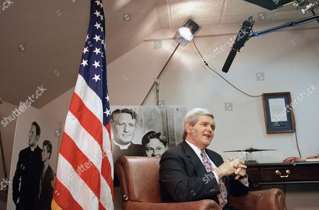 """Newt Gingrich House Speaker-elect Newt Gingrich sits in his Marietta, Ga., office on surrounded by production photographs of Spencer Tracy as a priest and Mickey Rooney as a boy from the 1938 motion picture """"Boys Town"""". Gingrich taped an introduction to the movie for Turner Network Television Monday. The film will be broadcast on TNT, Thursday, Dec. 29, 1994 at 8:00 p.m. EST. Boys Town, the country's first school for juvenile delinquents, the inspiration for the film, was founded near Omaha, Neb., in 1917. Gingrich was invited to introduce the film in part because the remarks he has made about such organizations have drawn criticism in recent weeks"""