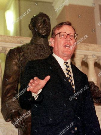 Stock Image of Northern Ireland First Minister David Trimble approaches reporters after meeting Sinn Fein President Gerry Adams in Stormont Parliament Buildings, Belfast Northern Ireland, - a historic first face to face encounter between the leaders of Irish Unionism and Irish Republicanism. Behind is a statue of Northern Ireland's first Premier, Lord Craigavon