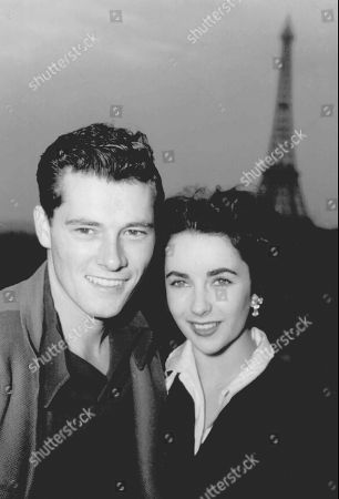 HILTON Actress Elizabeth Taylor poses with her new husband, hotel heir Nick Hilton, as they stand on the terrace of their hotel room in Paris while on their honeymoon. Publicist Sally Morrison says Taylor died in Los Angeles of congestive heart failure at age 79