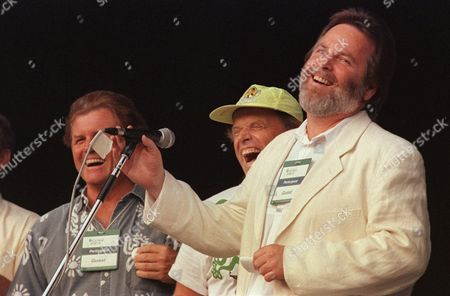 """WILSON Members of the singing group, """"The Beach Boys,"""" Carl Wilson, at microphone, Al Jardine, center, and Bruce Johnston are shown in this June 7, 1992 photo. Carl Wilson, a founding member of The Beach Boys and lead guitarist for the seminal surf band, has died from complications of lung cancer, his family said . Wilson died Friday evening in Los Angeles with his family at his side"""