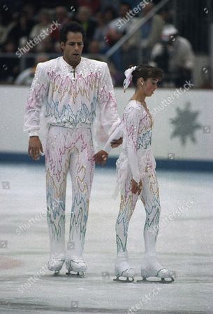 Stock Image of Canadian figure skaters Lloyd Eisler and Isabelle Brasseur leave the ice after performing their free program in the pairs event of the 1992 Winter Olympics, in Albertville, France. Brasseur fell during the performance but the couples manage to win the bronze medal
