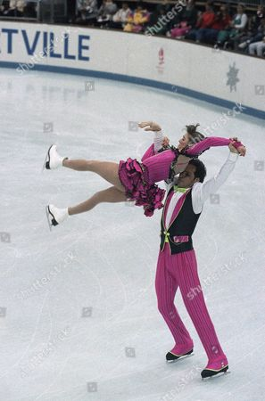 Canadian figure skaters Lloyd Eisler and Isabelle Brasseur form their pairs original program, in the first figure skating event of the XVI Winter Olympic Games, in Albertville, France day
