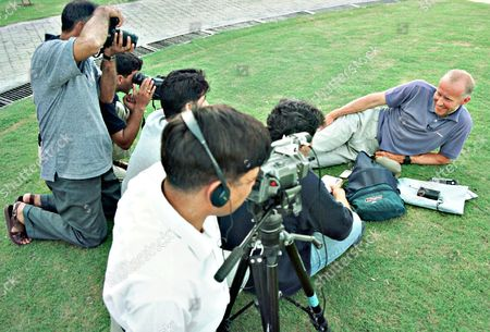 British mountaineer Alan Hinkes, surrounded by media people resting on the lawn of a local hospital, in Islamabad. Hinkes suffered a dislocated disc in his back while climbing in the Himalaya mountains. He was evacuated by army helicopter after he sought help on his satellite phone