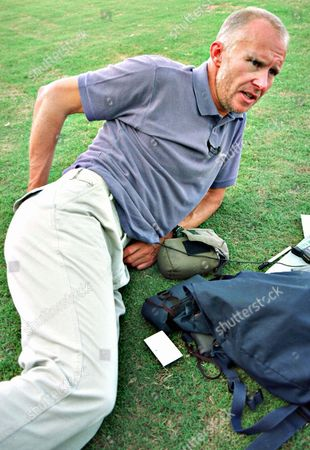 British mountaineer Alan Hinkes resting on a lawn of a local hospital, in Islamabad. Hinkes dislocated a disc in his back while climbing in the Himalaya mountains. He was evacuated by army helicopter after calling for help on his satellite phone from a base camp in the Himalayas