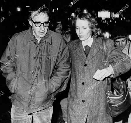 "Stock Picture of ALLEN FARROW FILE-- Woody Allen and actress Mia Farrow stroll up New York's 8th Avenue in this Jan. 1984 photo from files. Farrow says she hasn't spoken to her adopted daughter Soon-Yi Previn since 1992, when her ex-husband Woody Allen admitted having an affair with the young woman. ''As sure as death, Soon-Yi was gone from our lives,'' Farrow writes in her new book, ""What Falls Away,"" published"