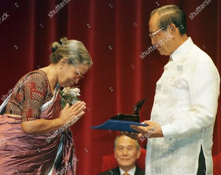 AWARD Philippine President Fidel Ramos presents the 1997 Ramon Magsaysay Award for Journalism, Literature and Creative Communication Arts to Mahasweta Devi of India during the awarding ceremony, in Manila. Devi is recognized for her compassionate crusade through art and activism to claim for tribal peoples a just and honorable place in India's national life