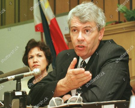 BUTLER GUTTIEREZ British Chief Constable Tony Butler of the Gloucestershire Constabulary gestures at a news conference Friday Oct.3, 1997 at the Justice Department in Manila wherein he announced the new agreement between the Philippines and Great Britain in combating child prostitution or Pedohilia. The agreement is worked out following increasing cases of pedophilia in the Philippines involving British nationals. At left is Mercy Guttierez of the Presidential Task Force on Child Abuse