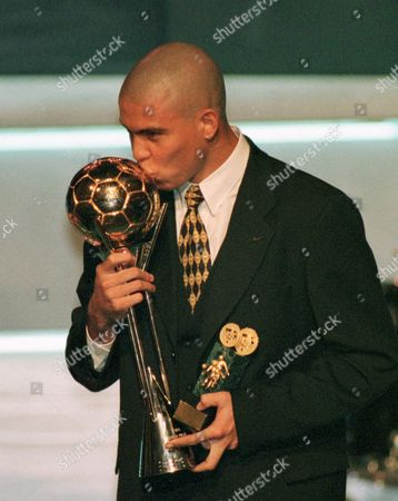 RONALDO Barcelona's Brazilian star striker Ronaldo kisses his FIFA player of the year trophy during an awards ceremony in Lisbon. Ronaldo, whose full name is Ronaldo Luis Nazario de Lima, received a total of 329 points, ahead of last year's winner AC Milan's Liberian George Weah with 140 points and Newcastle English striker Alan Shearer with 123 points