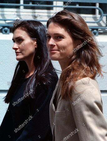 SPENCER DIVORCE Victoria Spencer, right, escorted by friend Chantelle Collopy, arrives outside the Cape Town High Court Monday, November 24. 1997 where divorce proceedings were started between Spencer and her husband Earl Spencer, brother of the late Princess Diana. Monday's hearings were to decide if his divorce from former model Victoria Lockwood will take place in Britain or his adopted home of South Africa