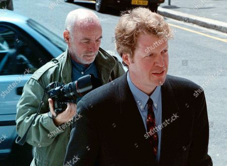 SPENCER DIVORCE Earl Spencer, front,brother of the late Princess Diana, is followed by a press photographer, outside Cape Town's High Court Monday's hearings are to decide if his divorce from former model Victoria Lockwood will take place in Britain or his adopted home of South Africa